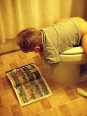 kid-reads-on-toilet
